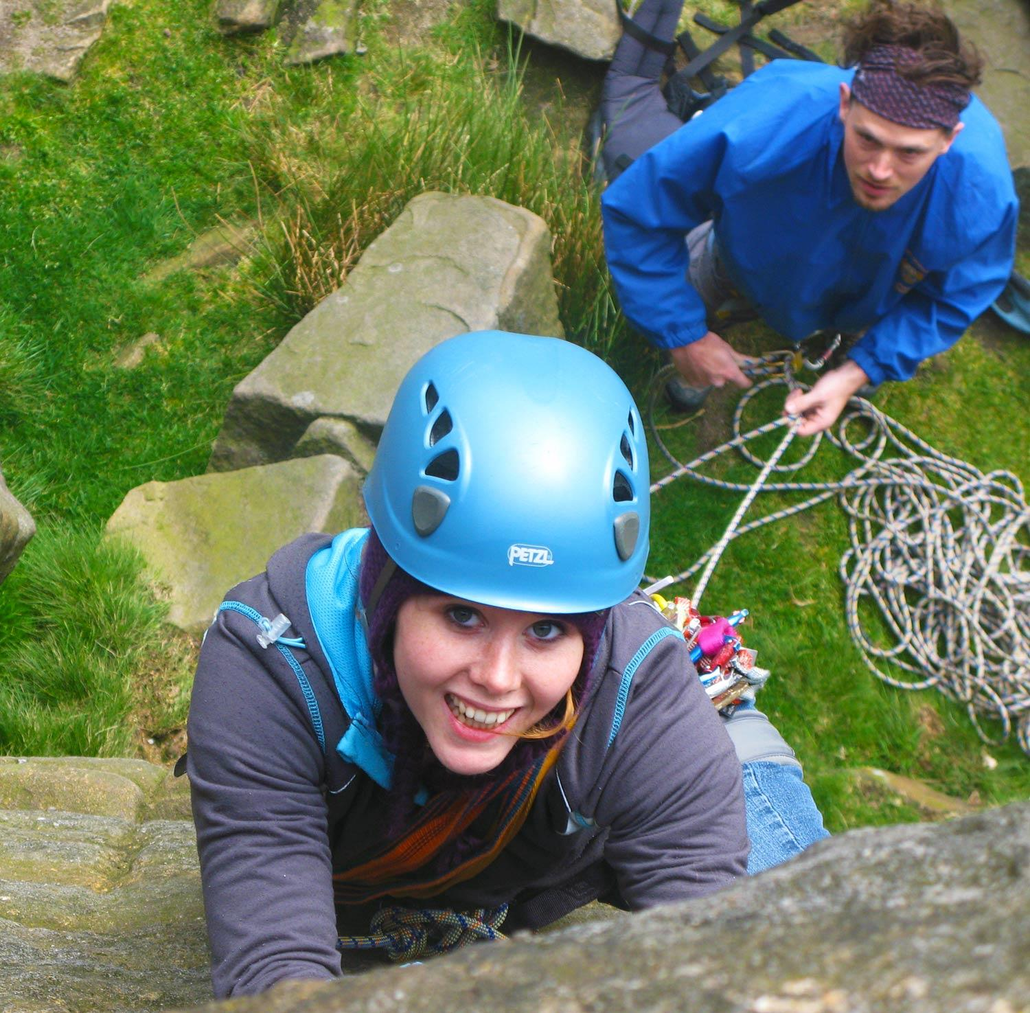 A guest tries her hand at rock climbing in the peak district
